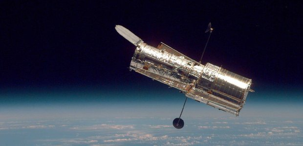 Hubble Space Telescope above Earth.